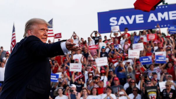 Former U.S. President Donald Trump tosses out a hat during his first post-presidency campaign rally at the Lorain County Fairgrounds in Wellington, Ohio, U.S., June 26, 2021 - Sputnik International