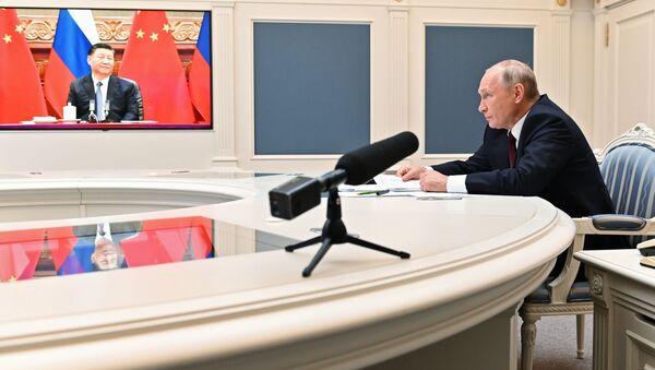 Russia's President Vladimir Putin and China's leader Xi Jinping - Sputnik International