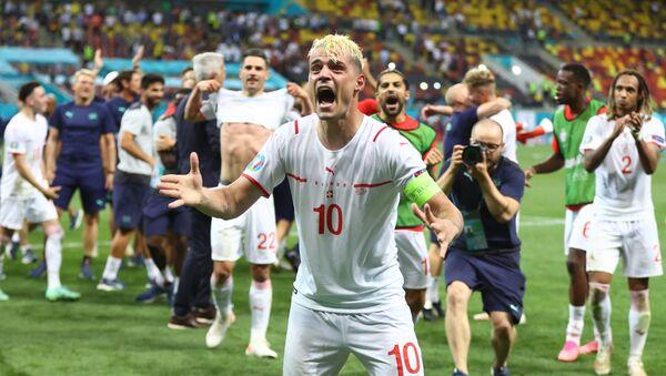 Soccer Football - Euro 2020 - Round of 16 - France v Switzerland - National Arena Bucharest, Bucharest, Romania - June 29, 2021   Switzerland's Granit Xhaka celebrates after the match - Sputnik International