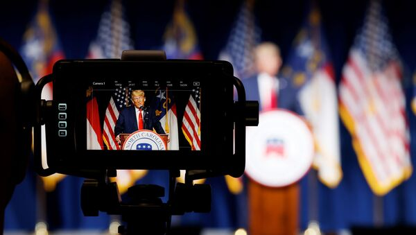 Former U.S. President Donald Trump is seen in a live television monitor as he speaks at the North Carolina GOP convention dinner in Greenville, North Carolina, U.S. June 5, 2021 - Sputnik International