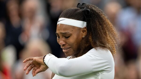 Tennis - Wimbledon - All England Lawn Tennis and Croquet Club, London, Britain - June 29, 2021 Serena Williams of the U.S. reacts after sustaining an injury before retiring from her first round match against Belarus' Aliaksandra Sasnovich - Sputnik International