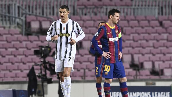 Juventus' Portuguese forward Cristiano Ronaldo (L) walks past Barcelona's Argentinian forward Lionel Messi during the UEFA Champions League group G football match between Barcelona and Juventus at the Camp Nou stadium in Barcelona on December 8, 2020 - Sputnik International