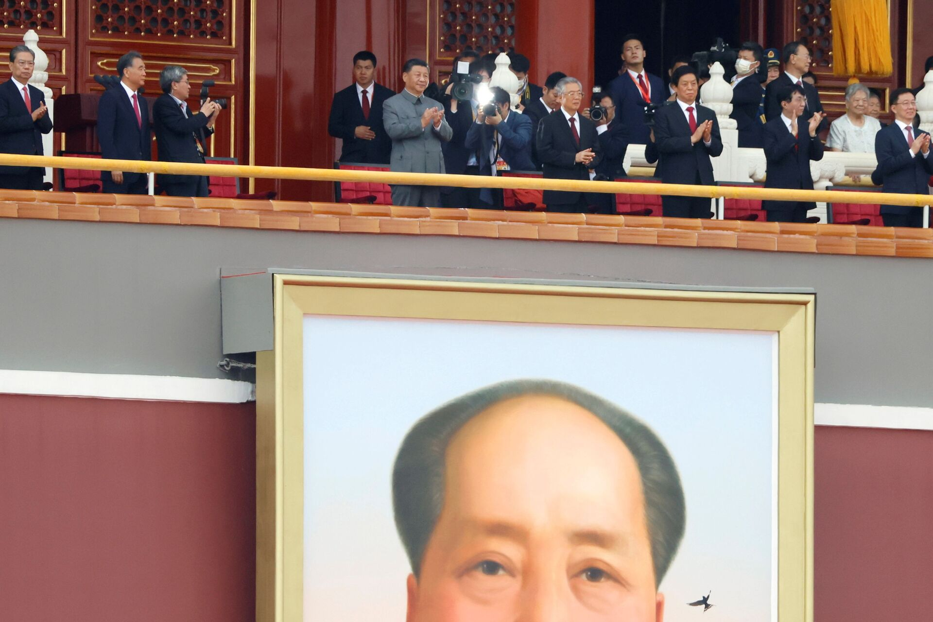 Chinese President Xi Jinping applauds above a giant portrait of late Chinese chairman Mao Zedong at the event marking the 100th founding anniversary of the Communist Party of China, on Tiananmen Square in Beijing, China 1 July 2021.  - Sputnik International, 1920, 07.09.2021