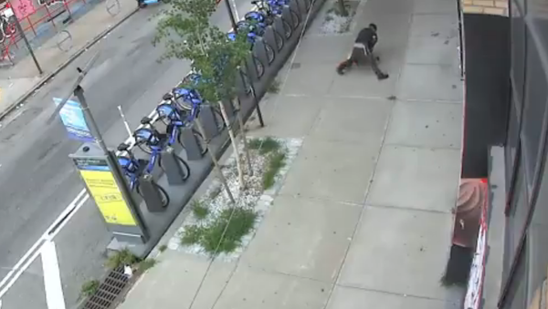 Screenshot from a NYPD video showing a man tackling a woman and groping her in Brooklyn, New York City - Sputnik International