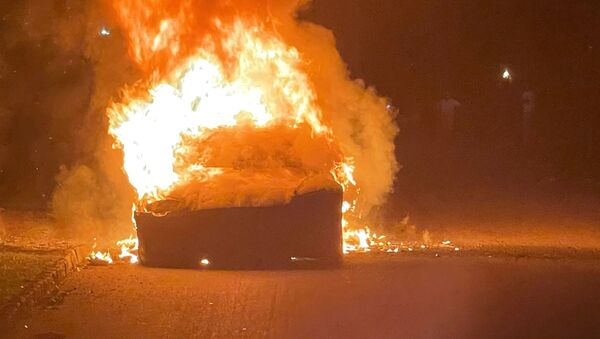 Tesla Inc's new Model S Plaid electric car is seen in flames in Pennsylvania, U.S., in this handout photo provided to Reuters on July 2, 2021. - Sputnik International