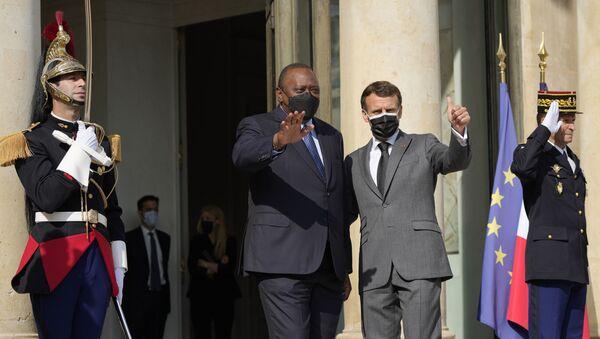French President Emmanuel Macron waves with Kenyan President Uhuru Kenyatta before their talks Thursday, July 1, 2021 in Paris. - Sputnik International