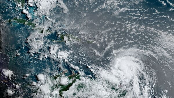 This satellite image provided by the National Oceanic and Atmospheric Administration shows Hurricane Elsa moving through the Caribbean, over Barbados, Tuesday, July 2, 2021, at 12:00 Z (8am a.m. ET). Elsa was expected to pass near the southern coast of Hispaniola on Saturday and to move near Jamaica and portions of eastern Cuba on Sunday. (NOAA/NESDIS/STAR GOES via AP) - Sputnik International