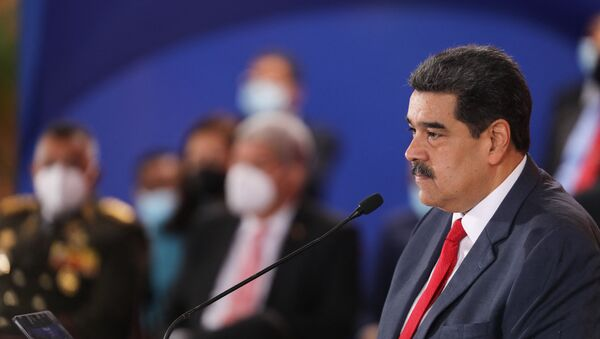 Handout picture released by the Venezuelan presidency showing Venezuelan President Nicolas Maduro, speaking during the Bolivarian Alliance for the Peoples of America (ALBA) Summit at the Miraflores presidential palace in Caracas, on June 24, 2021. - Sputnik International