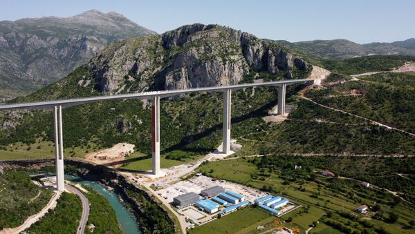 Drone picture shows Moracica bridge on the first leg of a new highway in Montenegro, linking the port of Bar with the border of Serbia, built with a large Chinese loan that has sent Montenegro's debt soaring, Picture taken May 25, 2021. - Sputnik International