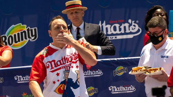 Competitive eating champion Joey Jaws Chestnut wins the 2021 Nathan's Famous 4th Of July International Hot Dog Eating Contest with 76 hot dogs, breaking his personal best record of 75 at Coney Island on July 4, 2021 in New York City. The first Fourth of July Hot Dog Eating Contest dates back to 1916, the year Nathan's Famous opened on Surf Avenue in Coney Island.  - Sputnik International
