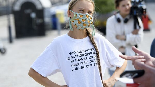 Swedish climate activist Greta Thunberg and other climate protesters gather for a protest against climate change in front of the Swedish parliament building in Stockholm, Sweden, on June 18, 2021. - Sputnik International
