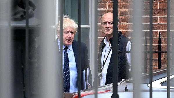 Britain's Prime Minister Boris Johnson (L) and his special advisor Dominic Cummings leave from the rear of Downing Street in central London on September 3, 2019, before heading to the Houses of Parliament - Sputnik International