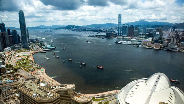 Fishing boats sail through Victoria harbour in Hong Kong on 1 July 2019 - Sputnik International