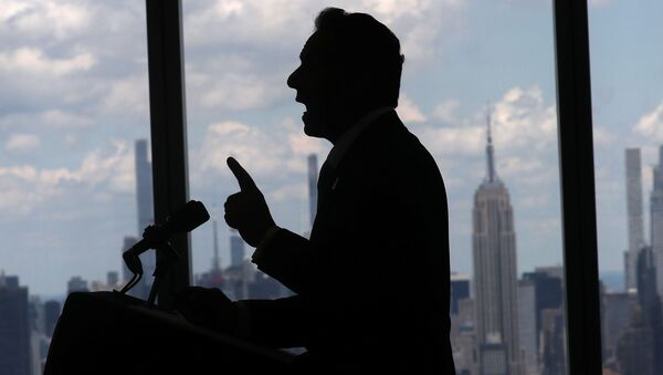 New York Governor Andrew Cuomo speaks with the skyline of Manhattan behind him from the One World Trade Center Tower while making an announcement in New York City, New York, U.S., June 15, 2021. - Sputnik International