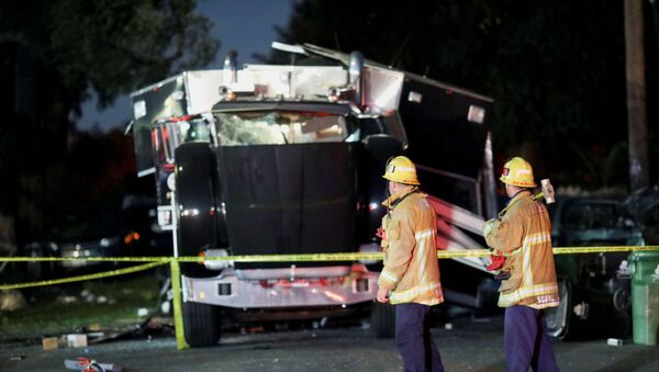 A damaged vehicle is seen at the site of an explosion after police attempted to safely detonate illegal fireworks that were seized, in Los Angeles, California, U.S., June 30, 2021 - Sputnik International