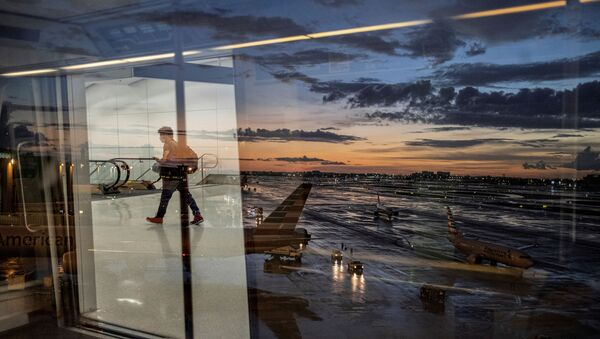 A passenger arrives at terminal D of Miami International Airport after heavy rains, as Hurricane Elsa moves towards south Florida, in Miami, U.S. July 2, 2021. - Sputnik International
