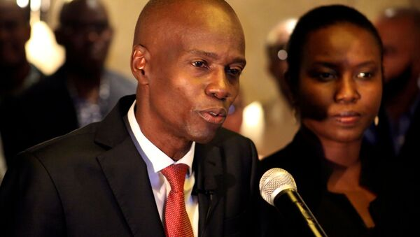 FILE PHOTO: Jovenel Moise addresses the media next to his wife Martine after winning the 2016 presidential election, in Port-au-Prince, Haiti. Picture taken 28 November 2016 - Sputnik International