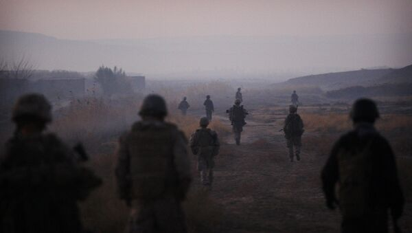 United States Marines from the 2nd Battalion 2nd Marines Warlords and Afghan National Army soldiers walk in formation during an operation in the Garmsir district of the volatile Helmand province, southern Afghanistan, Wednesday, Dec. 23, 2009 - Sputnik International