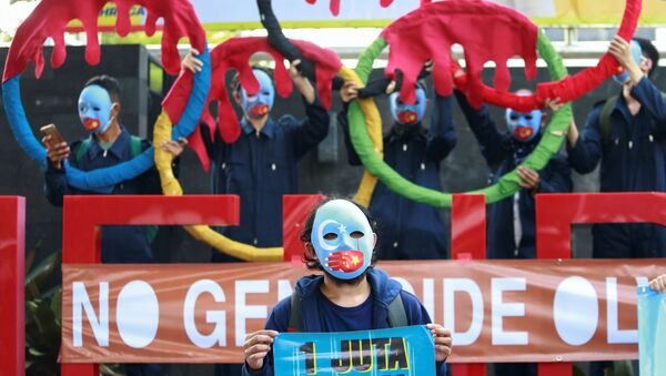 Activists wearing masks take part in a protest to boycott the Beijing 2022 Winter Olympic Games outside the Ministry of Youth and Sport of the Republic of Indonesia building in Jakarta, Indonesia, June 25, 2021 - Sputnik International