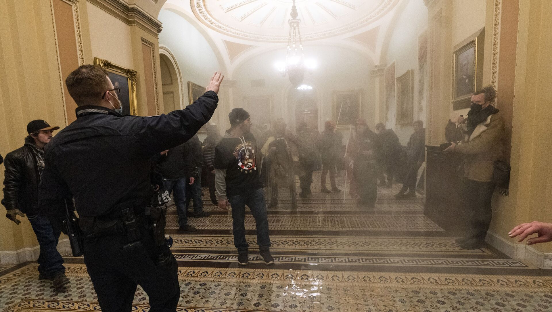 FILE - In this Jan. 6, 2021, file photo, smoke fills the walkway outside the Senate Chamber as rioters are confronted by U.S. Capitol Police officers inside the Capitol in Washington - Sputnik International, 1920, 24.07.2021