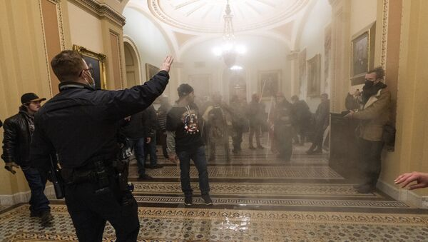 FILE - In this Jan. 6, 2021, file photo, smoke fills the walkway outside the Senate Chamber as rioters are confronted by U.S. Capitol Police officers inside the Capitol in Washington - Sputnik International