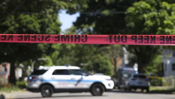 Police tape marks off a Chicago street as officers investigate the scene of a fatal shooting in the city's South Side on Tuesday, June 15, 2021. An argument in a house erupted into gunfire early Tuesday, police said. - Sputnik International