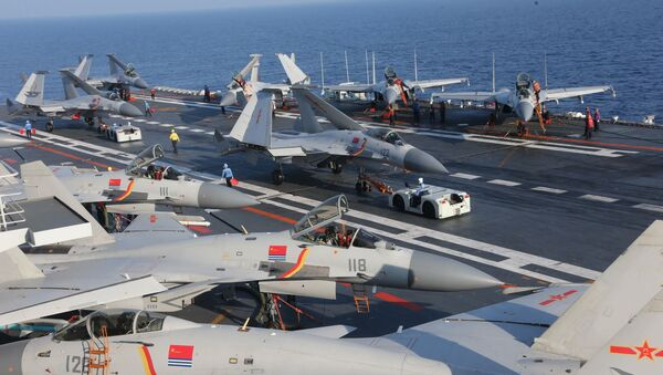 People's Liberation Army Navy J-15 Flying Shark fighters parked about the Chinese aircraft carrier Liaoning - Sputnik International
