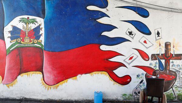 A man speaks on a phone next to a mural in the Little Haiti neighborhood of Miami, Florida, U.S., July 8, 2021. - Sputnik International