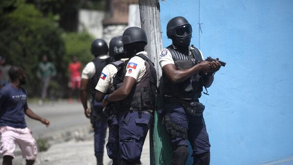 Police officers patrol in search for suspects in the murder Haiti's President Jovenel Moise, in Port-au-Prince, Haiti, Thursday, July 8, 2021. Moise was assassinated in an attack on his private residence early Wednesday. - Sputnik International