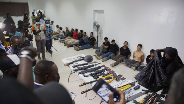 Suspects in the assassination of Haiti's President Jovenel Moise are shown to the media, along with the weapons and equipment they allegedly used in the attack, at the General Direction of the police in Port-au-Prince, Haiti, Thursday, July 8, 2021. - Sputnik International