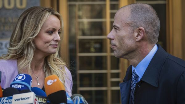In this April 16, 2018, file photo, adult film actress Stormy Daniels, left, stands with her then lawyer, Michael Avenatti, during a press conference outside federal court in New York. A trial for Avenatti to face charges that he cheated ex-client Daniels out of proceeds from her book was delayed Friday, Jan. 8, 2021, until next year - Sputnik International