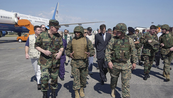 Chairman of the Joint Chiefs of Staff General Richard B. Myers talks with Brigadier General Ronald S. Coleman after disembark from a United States Air Force Boeing C-32 at Toussaint Louverture International Airport during a visit to Port-au-Prince, Haiti to inspect U.S. Troops deployed to Haiti as part of peacekeeping operations in Haiti. - Sputnik International