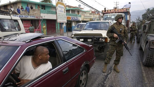 U.S. Marines from the 3rd Battalion, 8th Marine Regiment, Camp Lejeune, N.C., patrol the streets of Port-au-Prince, Haiti, on March 9, 2004. U.S. troops are deployed to Haiti at the request of the new Haitian President to help promote the constitutional political process, to prepare for the arrival of a U.N. multinational force, facilitate humanitarian assistance, and secure key sites in the capital of Port-au-Prince. - Sputnik International
