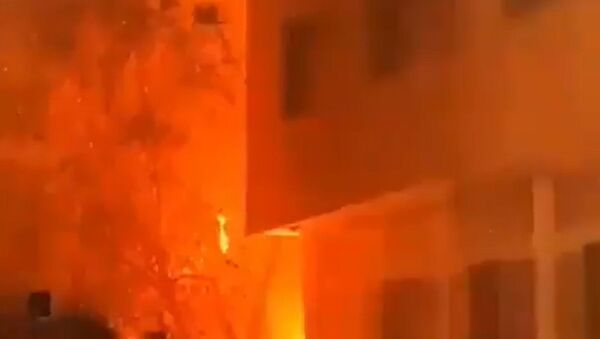 Screenshot captures a massive fire that consumed a residential building in the western district of Tehran, Iran. It is believed that the blaze was caused by a malfunction with the building's gas system; however, an investigation is ongoing. - Sputnik International