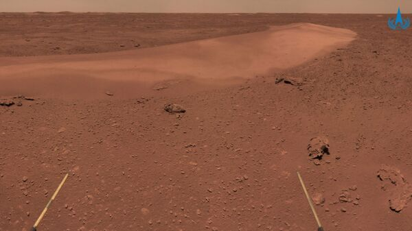 This handout photograph taken on June 26, 2021 and released on July 9, 2021 by the China National Space Administration (CNSA) shows the surface of Mars taken from China's Zhurong Mars rover. - Sputnik International