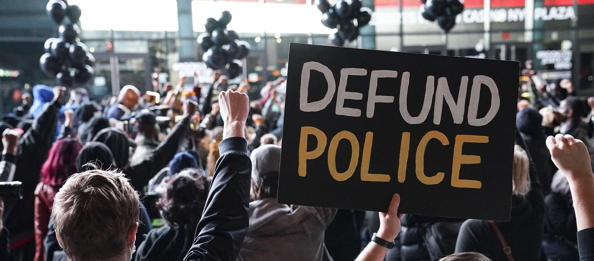 In this 14 October 2020 file photo, a protester holds a sign that reads Defund Police during a rally for the late George Floyd outside Barclays Center in New York - Sputnik International, 1920, 10.07.2021
