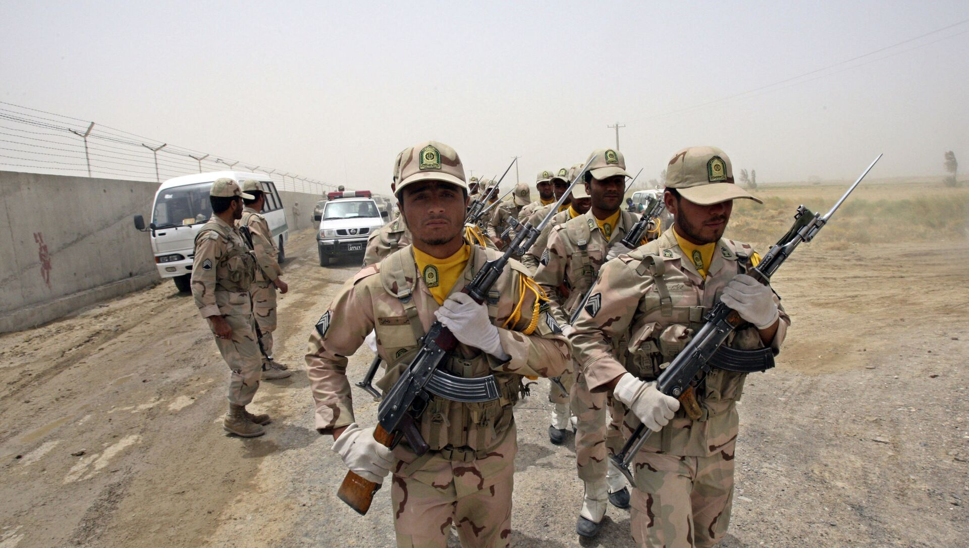 In this Tuesday, July 19, 2011 file photo, a group of Iranian border guards march at the eastern border of Iran shared with Pakistan and Afghanistan near Zabol, Sistan and Baluchestan Province, Iran.  - Sputnik International, 1920, 26.07.2021