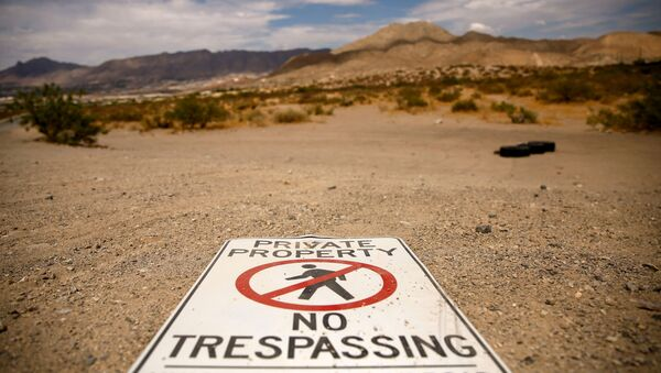 A sign is seen in the desert near the border between Mexico and the United States in Sunland Park, New Mexico, U.S., June 23, 2021. - Sputnik International