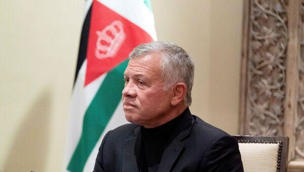 Jordan's King Abdullah II listens during a meeting in Amman, Jordan, May 26, 2021. - Sputnik International