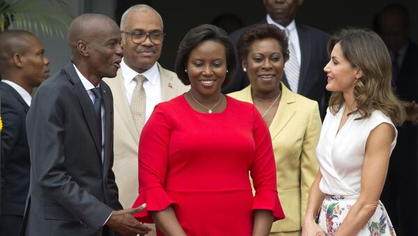 In this May 23, 2018, file photo, Haiti's President Jovenel Moise, left, and First Lady Martine Moise, in red, receive Spain's Queen Letizia Ortiz at the national Palace in Port-au-Prince, Haiti, Wednesday, May 23, 2018. - Sputnik International