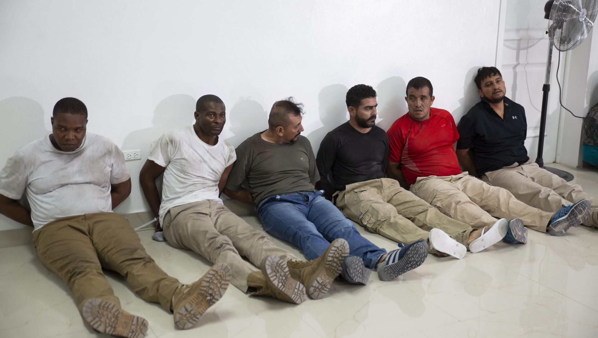 Suspects in the assassination of Haiti's President Jovenel Moise, among them Haitian-American citizens James Solages, left, and Joseph Vincent, second left, are shown to the media at the General Direction of the police in Port-au-Prince, Haiti, Thursday, July 8, 2021 - Sputnik International, 1920, 30.07.2021
