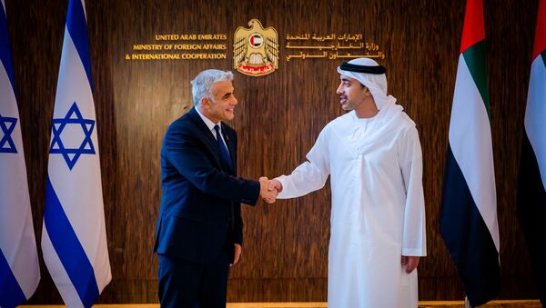 Israel's Foreign Minister Yair Lapid shakes hands with United Arab Emirates' Foreign Minister Sheikh Abdullah bin Zayed al-Nahyan in Abu Dhabi, UAE June 29, 2021. - Sputnik International