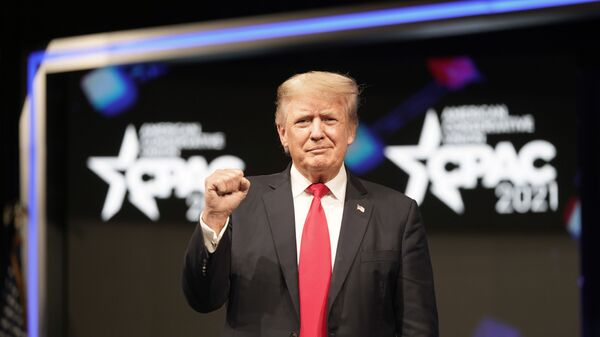 Former president Donald Trump raises his fist before speaking at the Conservative Political Action Conference (CPAC) Sunday, July 11, 2021, in Dallas.  - Sputnik International