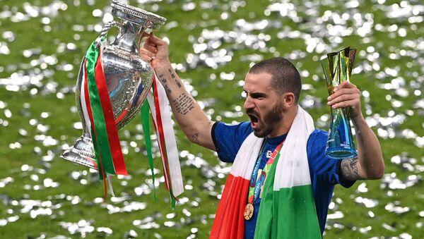 Soccer Football - Euro 2020 - Final - Italy v England - Wembley Stadium, London, Britain - July 11, 2021 Italy's Leonardo Bonucci celebrates with the trophy after winning Euro 2020  - Sputnik International