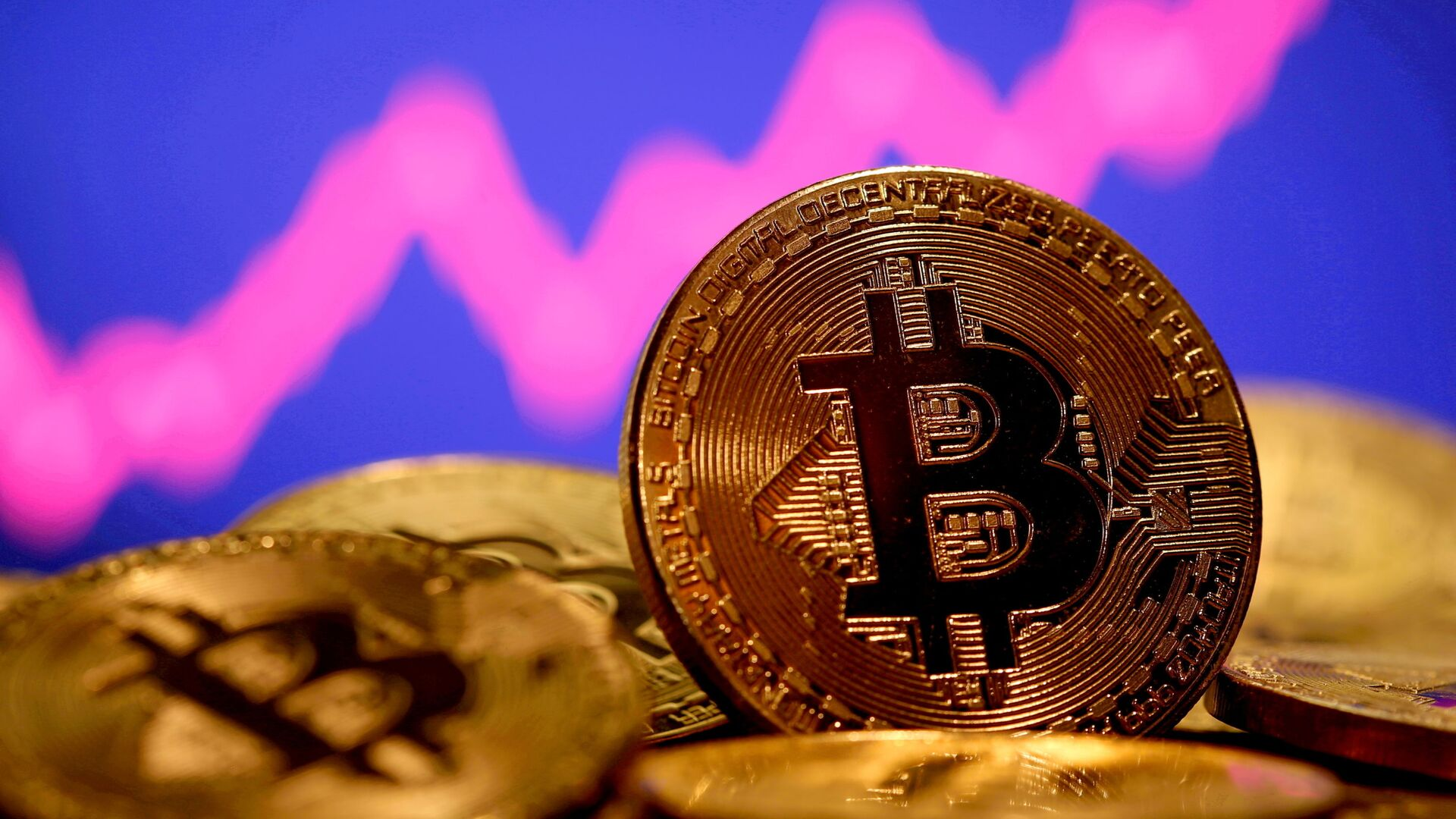 A representation of virtual currency Bitcoin is seen in front of a stock graph in this illustration taken January 8, 2021 - Sputnik International, 1920, 12.07.2021