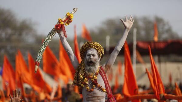 An Indian Hindu holy man shouts slogans during a meeting organized by the Vishva Hindu Parishad or the World Hindu Council at Sangam, the confluence of rivers the Ganges and the Yamuna during the annual Magh Mela festival in Allahabad, India, Friday, Jan. 19, 2018 - Sputnik International