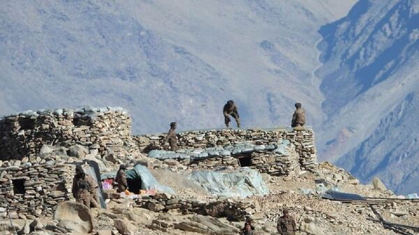 This photograph from the Indian Army, apparently shows Chinese troops dismantling bunkers at Pangong Tso region, in Ladakh along the India-China border on Monday, 15 February 2021. - Sputnik International