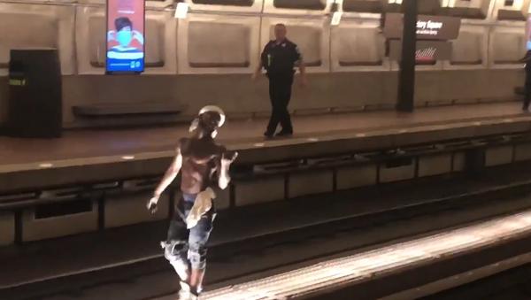 Screenshot from a video allegedly filmed inside the Washington DC Metro, where an unidentified man is seen walking on the tracks - Sputnik International
