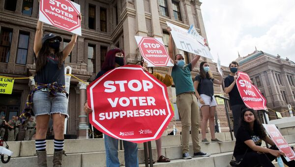 Voting rights activists gather during a protest against Texas legislators who are advancing a slew of new voting restrictions in Austin, Texas, U.S., May 8, 2021 - Sputnik International