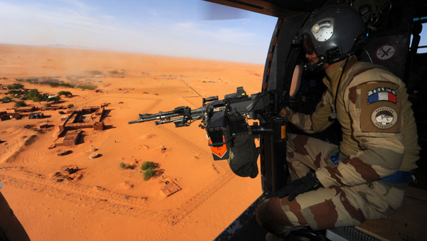 A French military helicopter over the Nigerien town Madama, which serves as a forward operating base for the French, Niger and Chad armies in Operation Barkhane - Sputnik International